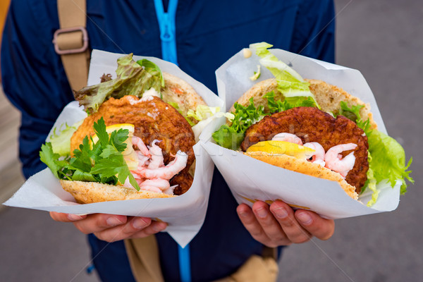 Fast street food seafood. Norway Lofoten Islands, fish cutlet wi Stock photo © cookelma