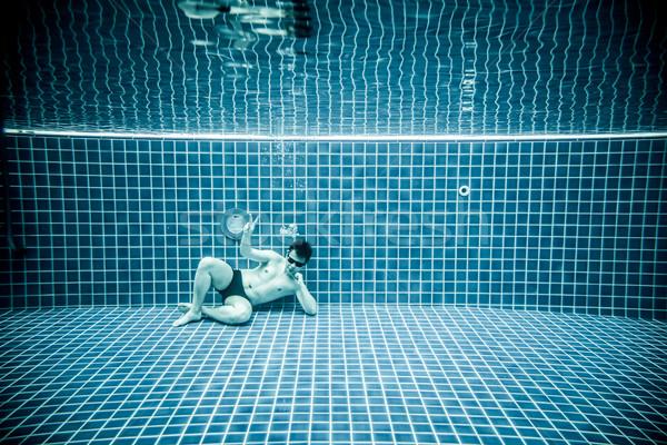Personas mentiras agua piscina hombre sol Foto stock © cookelma