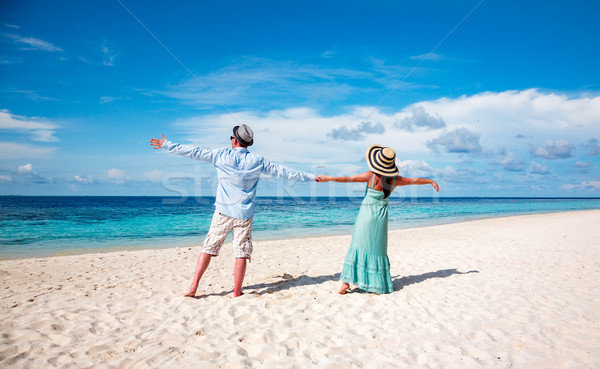 Vacation Couple walking on tropical beach Maldives. Stock photo © cookelma