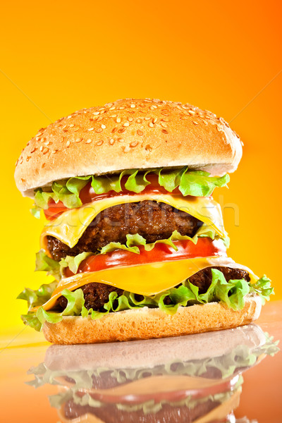 Tasty and appetizing hamburger on a yellow Stock photo © cookelma