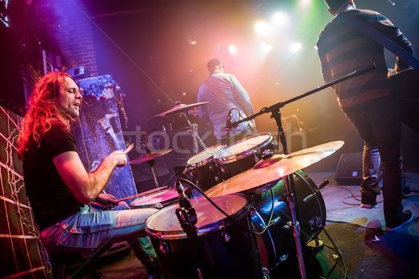 Stock photo: Drummer playing on drum set on stage.
