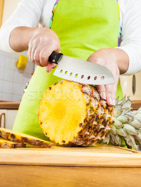 Woman's hands cutting pineapple Stock photo © cookelma