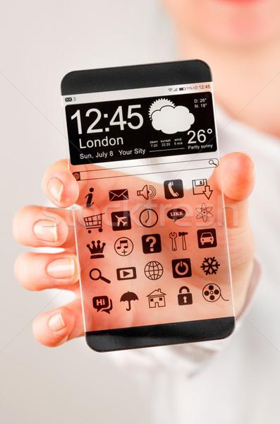 Сток-фото: смартфон · прозрачный · экране · человека · рук · отображения