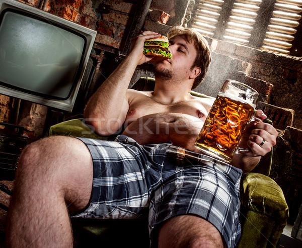 Grubas jedzenie hamburger fotel człowiek Zdjęcia stock © cookelma