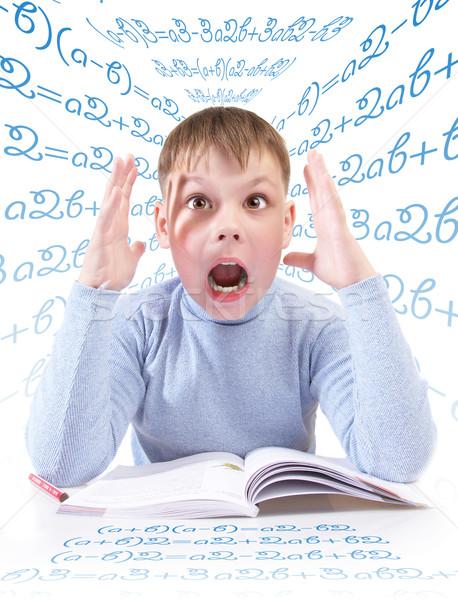 Stockfoto: Schooljongen · jongen · boek · achter · tabel · witte