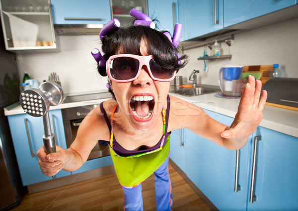 Crazy gospodyni domowa wnętrza kuchnia kobieta kobiet Zdjęcia stock © cookelma