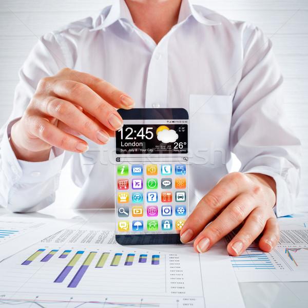 смартфон прозрачный экране человека рук футуристический Сток-фото © cookelma