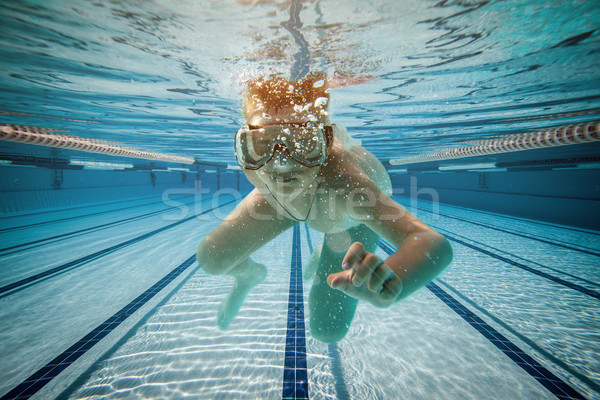 Boy swimming under water Stock photo © cookelma