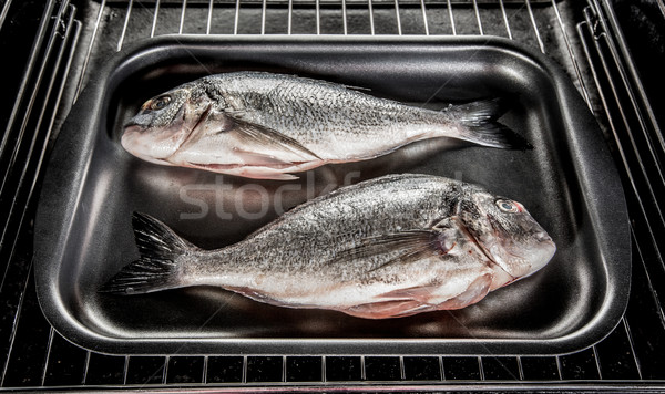 Dorado fish in the oven. Stock photo © cookelma