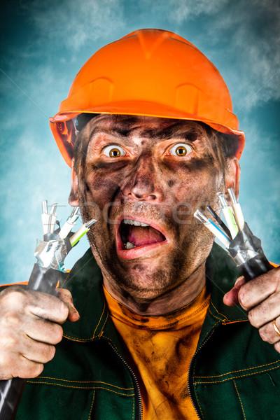 Elektromos rázkódás megrémült villanyszerelő férfi haj Stock fotó © cookelma