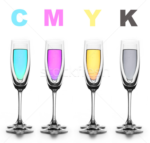 Four glasses with a different liquid on color. CMYK. Stock photo © cookelma