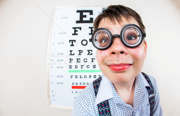 Person wearing spectacles in an office at the doctor Stock photo © cookelma