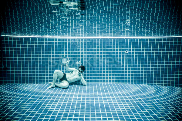 Persons lies under water in a swimming pool Stock photo © cookelma