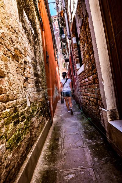 Nő keskeny utcák ház épület város Stock fotó © cookelma