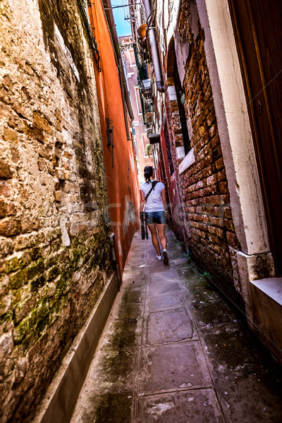 Woman walks through the narrow streets of Venice Stock photo © cookelma