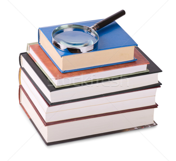Magnifying glass on books Stock photo © coprid