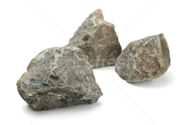 Roches trois pièces brut isolé blanche Photo stock © coprid
