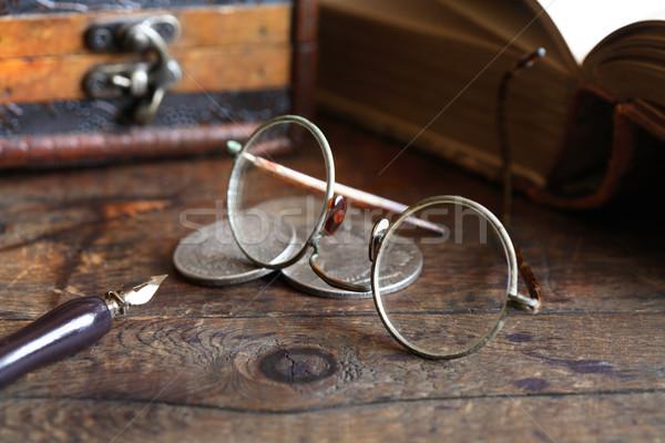 Három ősi ezüst érmék szemüveg toll Stock fotó © cosma