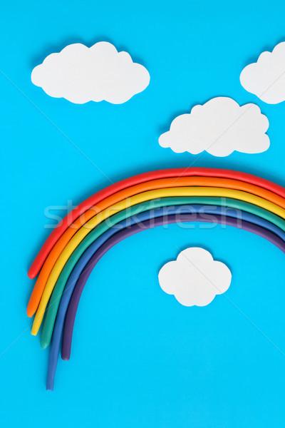 Regenboog witte papier wolken Blauw hemel Stockfoto © cosma