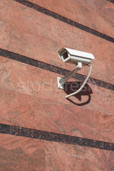 Biztonsági kamera biztonság modern irodaház fal város Stock fotó © cosma