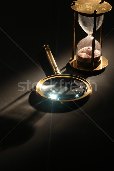 Hourglass And Magnifying Glass Stock photo © cosma