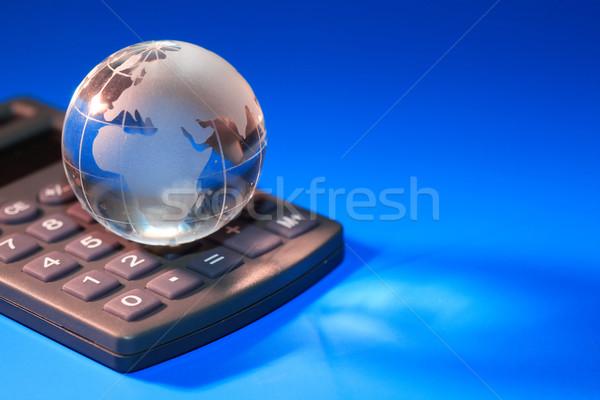 Global economia vidro globo calculadora azul Foto stock © cosma