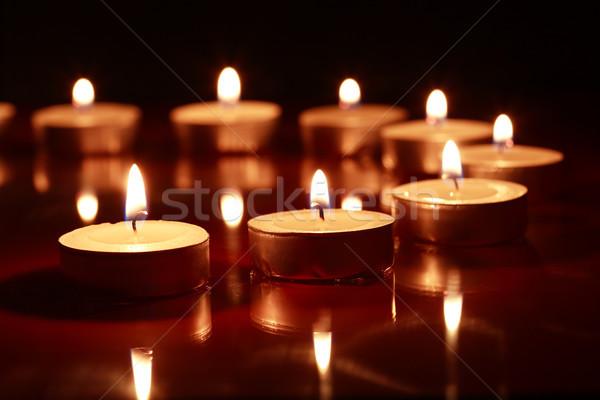 Gyertyák sötét szett világítás csetepaté láng Stock fotó © cosma