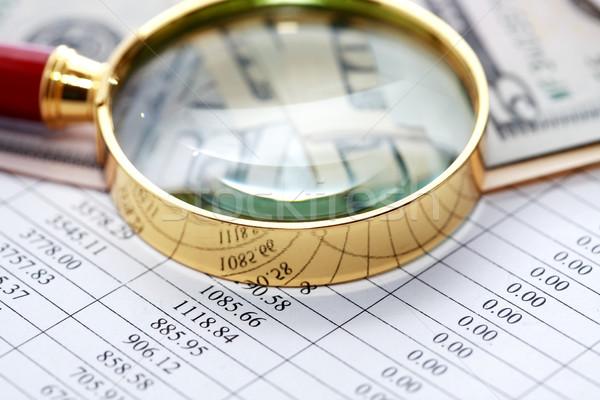 Nagyító pénz papír számjegyek asztal pénzügy Stock fotó © cosma
