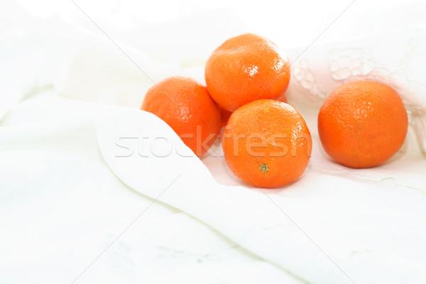 Tangerines On White Cloth Stock photo © cosma
