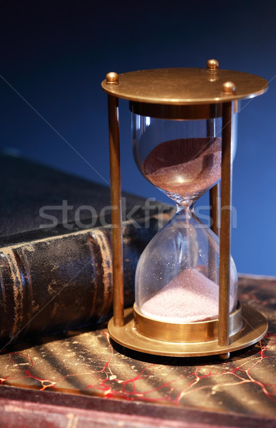 Hourglass On Book Stock photo © cosma