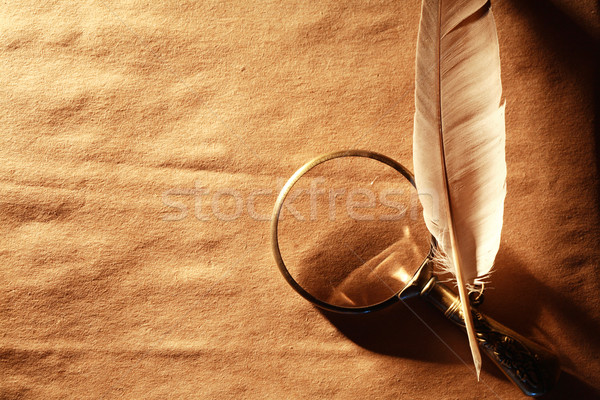 Magnifying Glass And Feather Stock photo © cosma