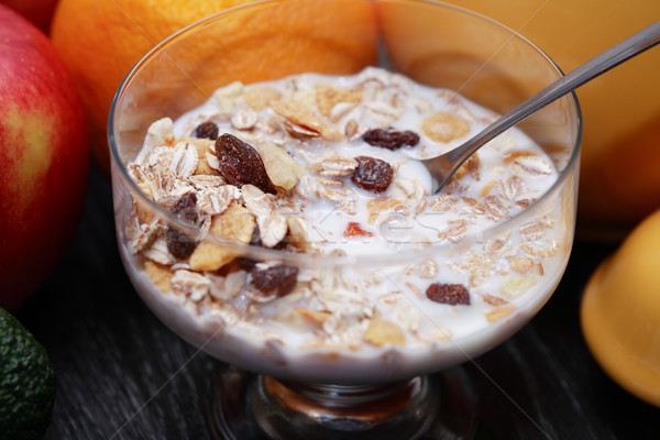 Tál müzli üveg tej gyümölcsök alma Stock fotó © cosma