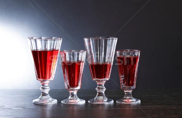 Koktélparti este ital kevés szemüveg piros Stock fotó © cosma