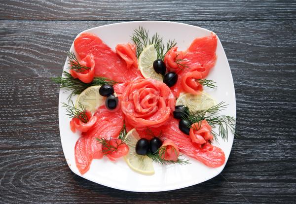 рыбы закуска пластина белый темно деревянный стол Сток-фото © cosma