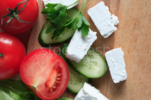 Fetasajt zöldségek saláta hozzávalók szeletel vágódeszka Stock fotó © cosma