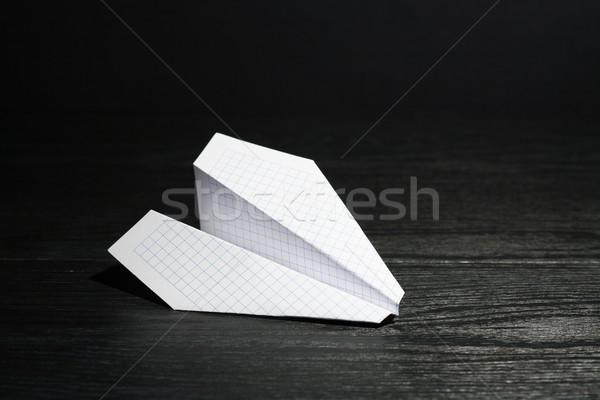 Avião de papel escuro branco conceito Foto stock © cosma