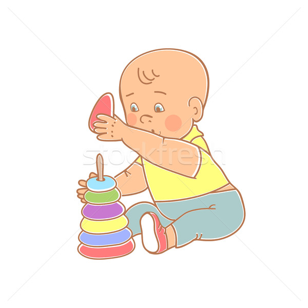 Little lovely baby boy playing with toys. Kid plays with pyramid Stock photo © cosveta