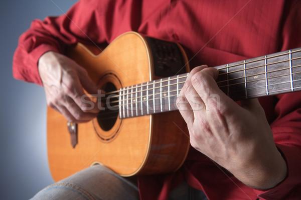 рук музыканта играет человека Сток-фото © courtyardpix