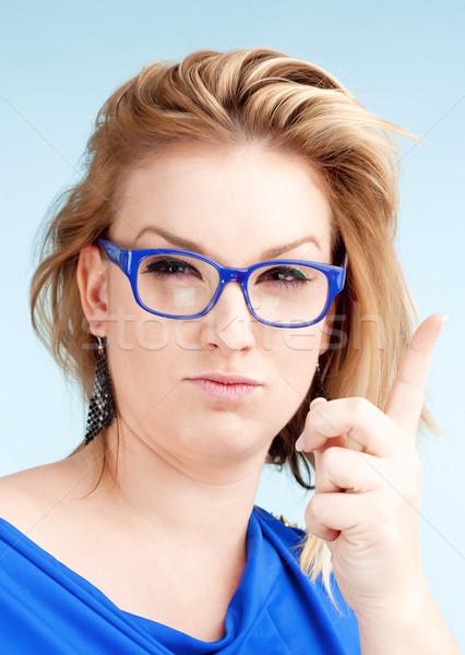 Jeune femme blond cheveux verres doigt Photo stock © courtyardpix