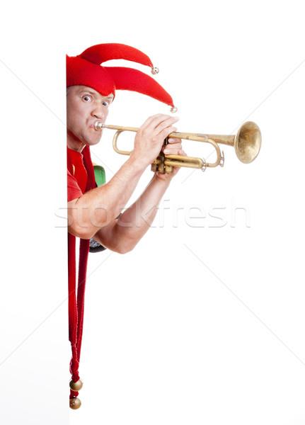 jester blowing trumpet Stock photo © courtyardpix