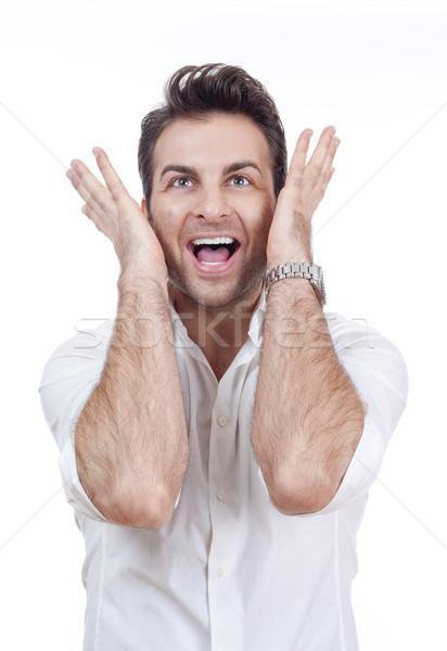 Stock fotó: Meglepődött · férfi · mosolyog · izgatott · póló · mindkettő