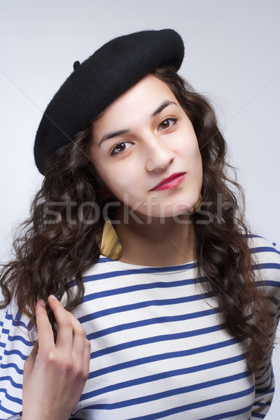 Woman with French Style Beret Hat and Striped T-shirt Stock photo © courtyardpix