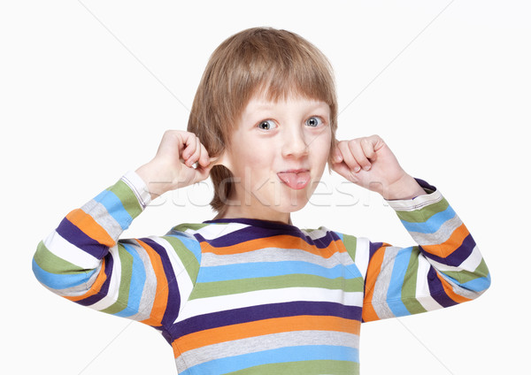 Boy Pulling his Ears and Sticking out Tongue  Stock photo © courtyardpix