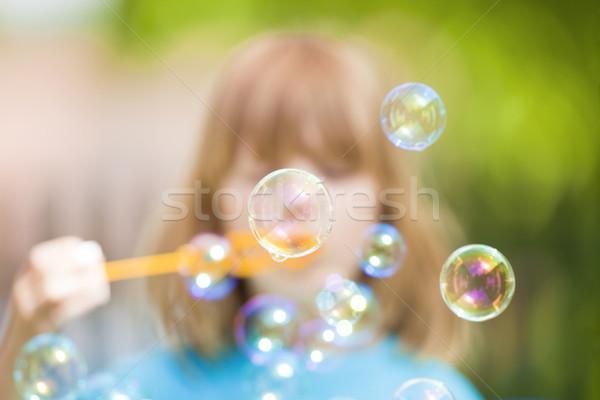 Fiú buborékfújás hosszú szőke haj fúj Stock fotó © courtyardpix