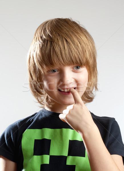 Fiú néz gondolkodik ujj száj izolált Stock fotó © courtyardpix