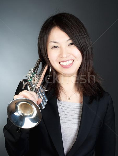 Retrato feminino trombeta jogador isolado branco Foto stock © courtyardpix