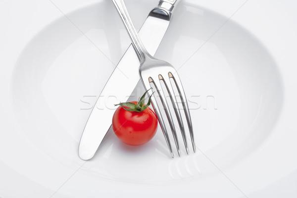 Tomate cherry placa tenedor cuchillo aislado blanco Foto stock © courtyardpix