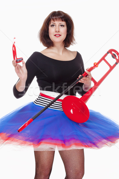 Young Female Musician with Red Trombone Dancing  Stock photo © courtyardpix