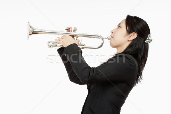 Portret vrouwelijke trompet speler geïsoleerd witte Stockfoto © courtyardpix