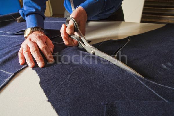 Tailor Cutting Fabric with Scissors. Stock photo © courtyardpix